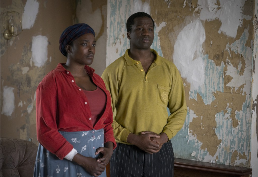 """This image released by Netflix shows Wunmi Mosaku as Rial Majur, left, and Ṣọpẹ Dìrísù as Bol Majur in a scene from """"His House."""" (Aidan Monaghan/Netfl..."""