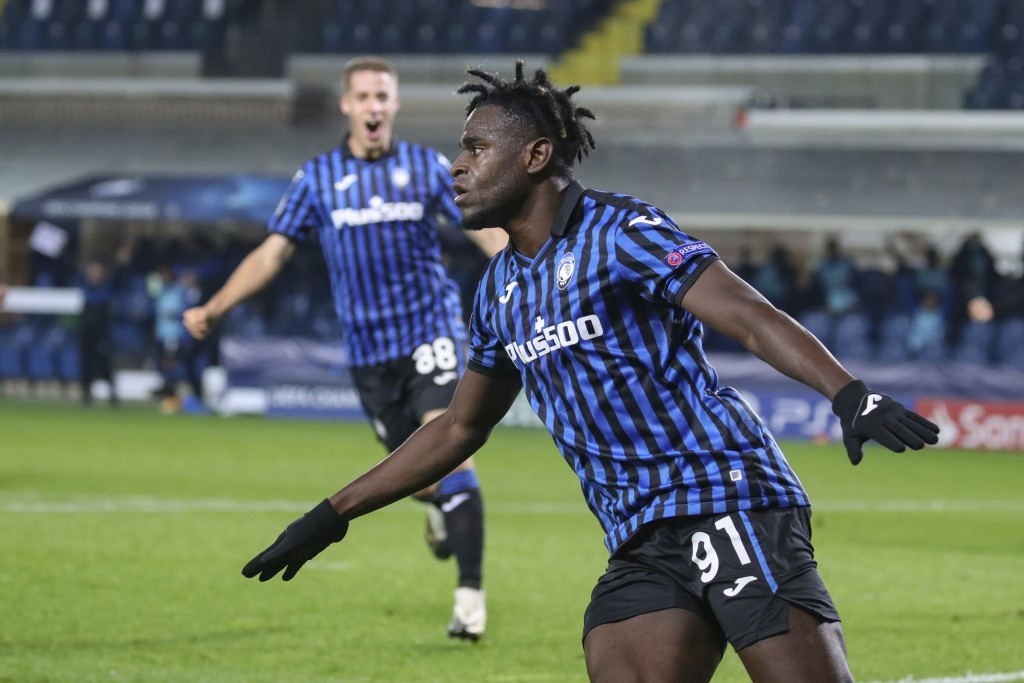 Atalanta's Duvan Zapata celebrates after scoring during the Champions League, group D soccer match between Atalanta and Ajax, at the Gewiss Stadium in...