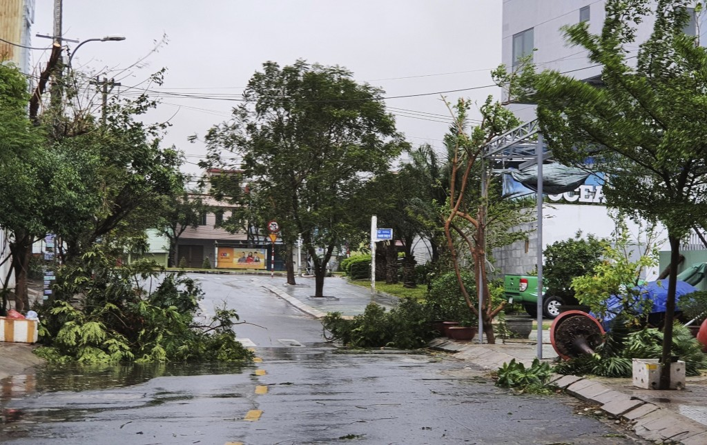 Broken tree branches caused by strong winds from typhoon Molave lie on a deserted street in Da Nang, Vietnam Wednesday, Oct. 28, 2020. Typhoon Malove ...