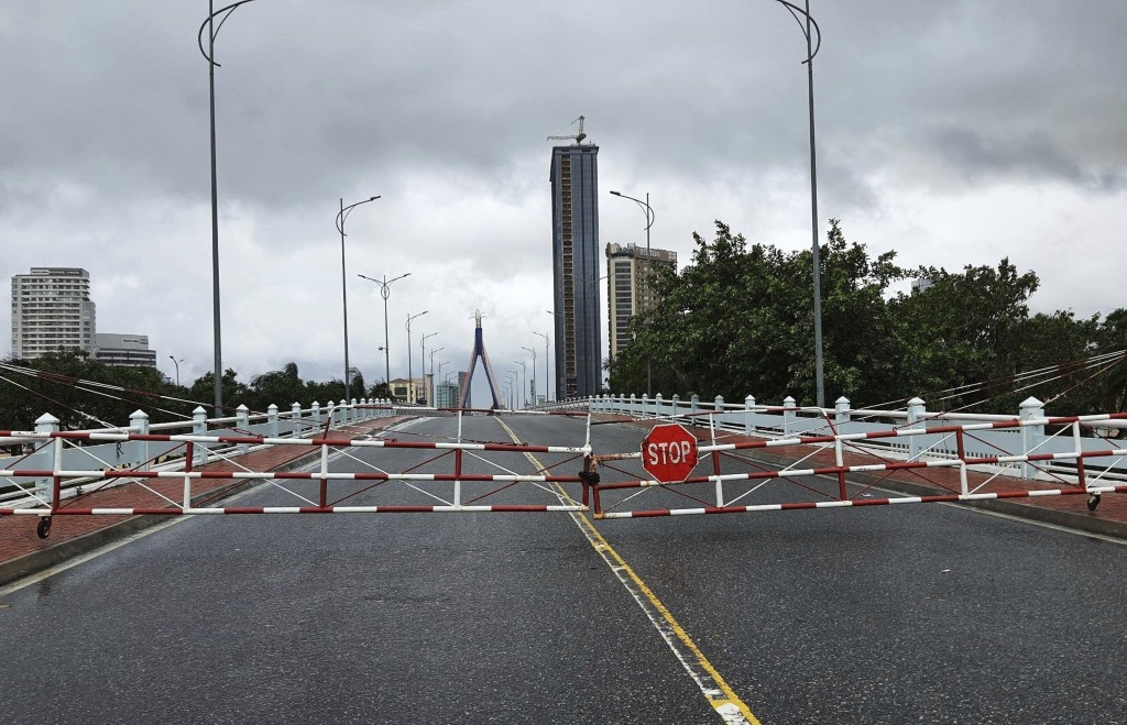 An empty street is barricaded ahead of Typhoon Molave in Da Nang, Vietnam Wednesday, Oct. 28, 2020. Typhoon Malove sank a few fishing boats as it appr...