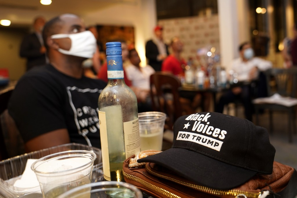 FILE - In this Sept. 29, 2020, file photo, a Black Voice for Trump cap sits on a table during a debate watch party hosted by the Miami Young Republica...