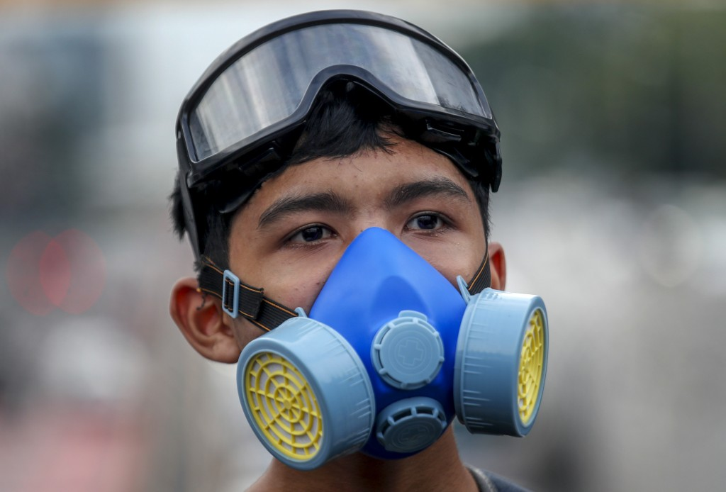 FILE - In this Oct. 19, 2020, file photo, a frontline pro-democracy student demonstrator in protective gear looks on during a rally in Bangkok, Thaila...