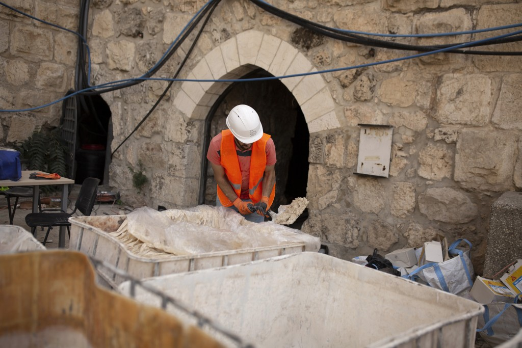 A worker prepares material to restore stone work inside the Tower of David Museum in the Old City of Jerusalem, Wednesday, Oct. 28, 2020. Jerusalem's ...