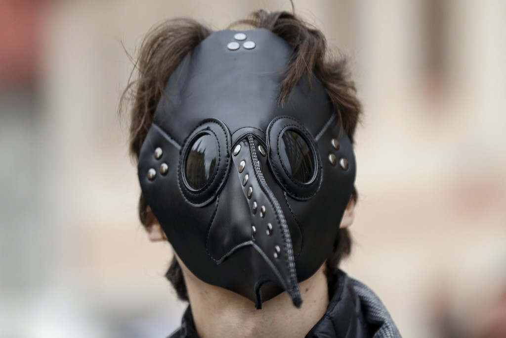 A man wears a mask as demonstrators gather to protest the COVID-19 preventative measures downtown Prague, Czech Republic, Wednesday, Oct. 28, 2020. Co...