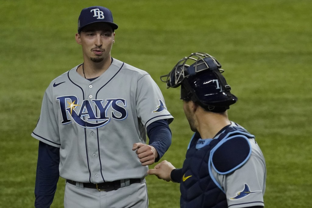 Tampa Bay Rays starting pitcher Blake Snell celebrates the end of the fifth inning with catcher Mike Zunino against the Los Angeles Dodgers in Game 6 ...