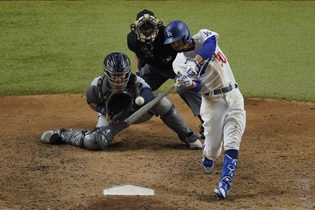 Los Angeles Dodgers' Mookie Betts hits a home run against the Tampa Bay Rays during the eighth inning in Game 6 of the baseball World Series Tuesday, ...
