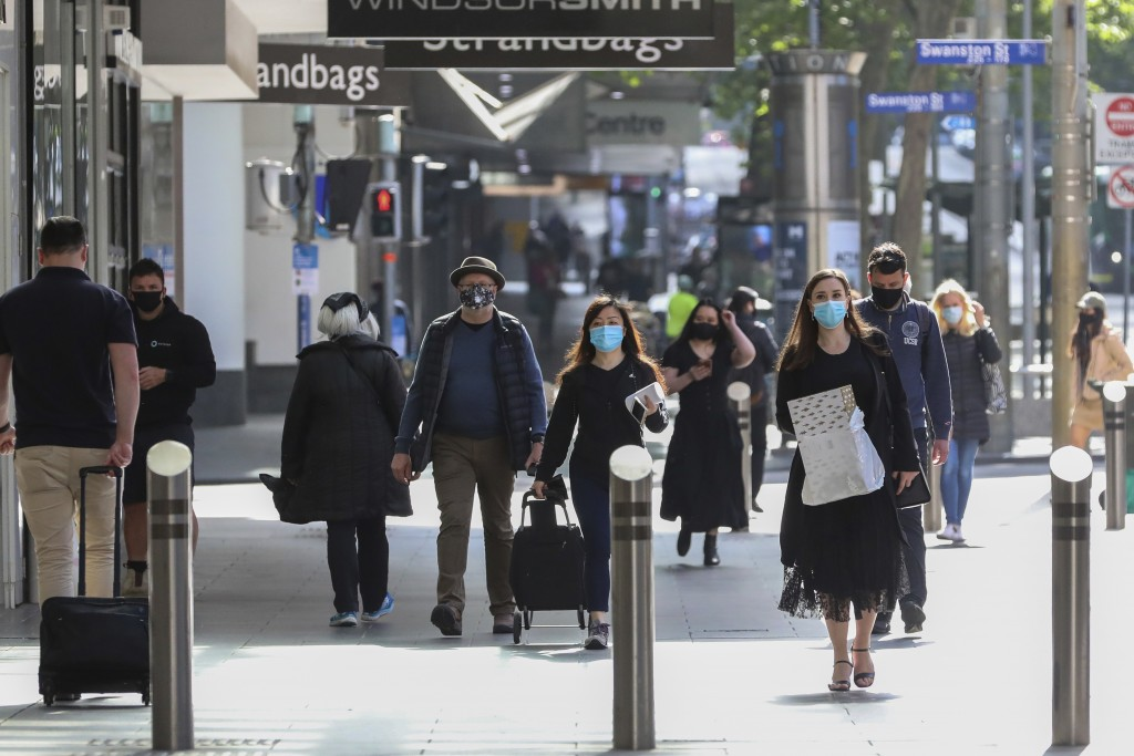 People walk through the Bourke Street Shopping mall in Melbourne, Australia, Wednesday, Oct. 28, 2020. Australia's second largest city of Melbourne wh...