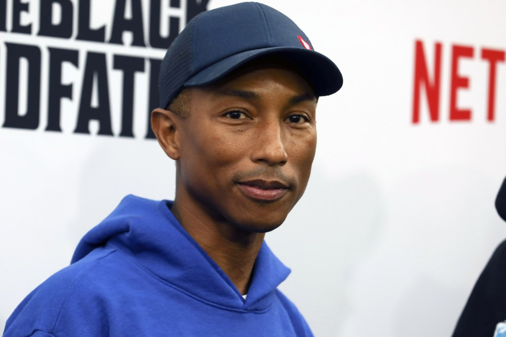 "FILE - Pharrell Williams attends the world premiere of ""The Black Godfather,"" in Los Angeles on  June 3, 2019. Dozens of artists have objected to Dona..."