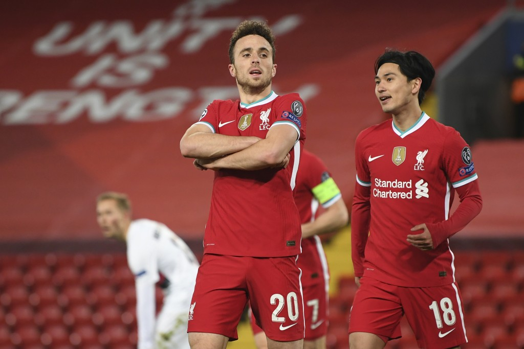 Liverpool's Diogo Jota, 20, celebrates scoring his side's first goal with Liverpool's Takumi Minamino, right, during the Champions League Group D socc...