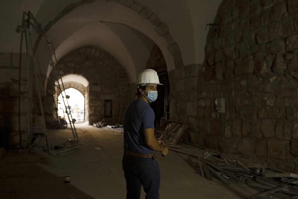 A staff member at the Tower of David Museum gives a tour to journalists in the Old City of Jerusalem, Wednesday, Oct. 28, 2020. The ancient citadel is...