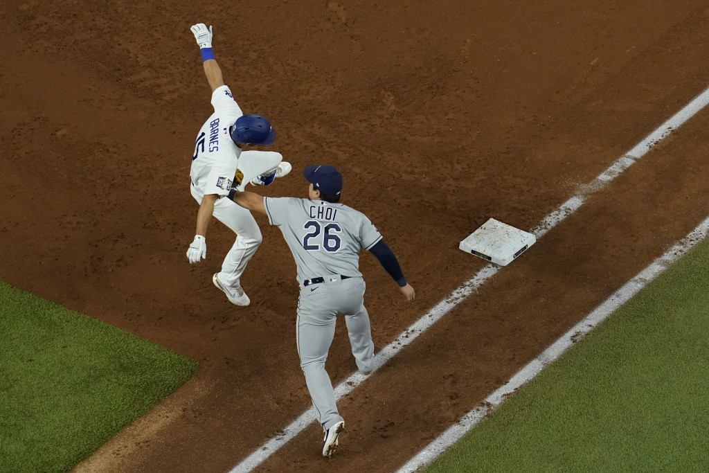 Tampa Bay Rays first baseman Ji-Man Choi tags out Los Angeles Dodgers' Austin Barnes during the third inning in Game 6 of the baseball World Series Tu...
