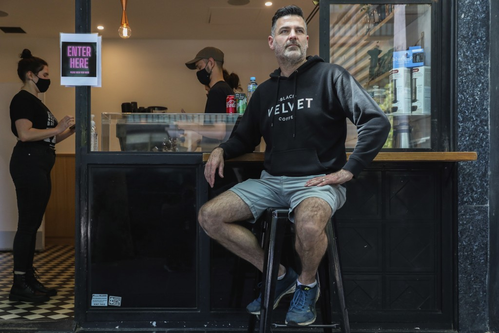 Director and founder of Black Velvet coffee shop Darren Silverman poses for a photo outside his cafe in Melbourne, Australia, Wednesday, Oct. 28, 2020...