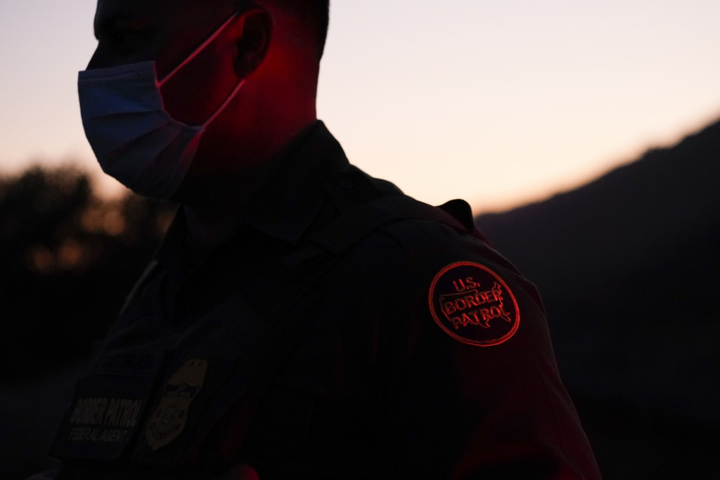 Border Patrol agent Justin Castrejon looks on near a section of new border structure Thursday, Sept. 24, 2020, near Tecate, Calif. President Donald Tr...