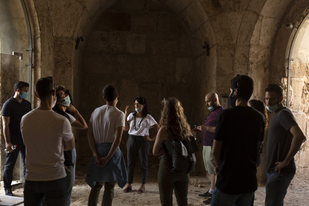 Eilat Lieber, center, Director and Chief Curator of the Tower of David Museum, leads a tour, in the Old City of Jerusalem, Wednesday, Oct. 28, 2020. T...