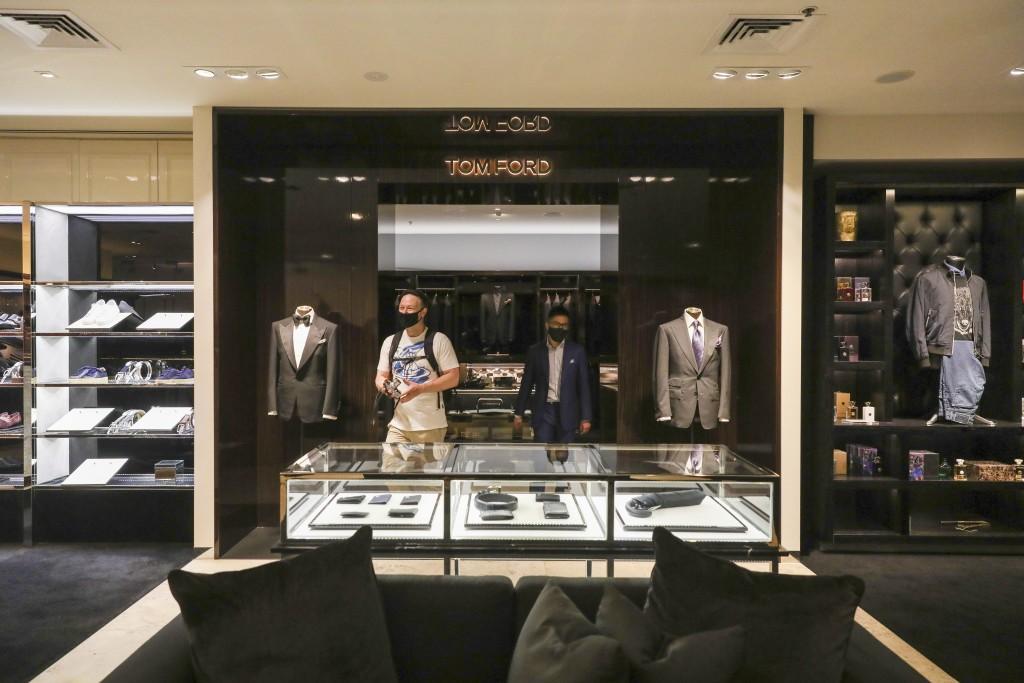 A customer visits high end luxury boutique department store Harrolds in Melbourne, Australia, Wednesday, Oct. 28, 2020. (AP Photo/Asanka Brendon Ratna...