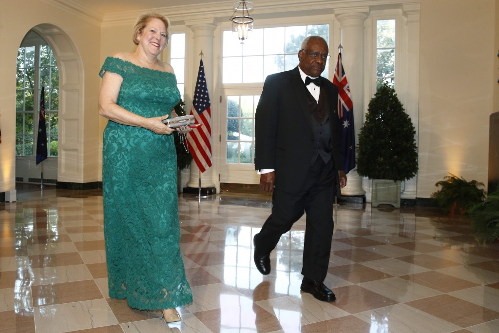 """FILE - In this Sept. 20, 2019, file photo, Supreme Court Associate Justice Clarence Thomas, right, and wife Virginia """"Ginni"""" Thomas arrive for a State..."""