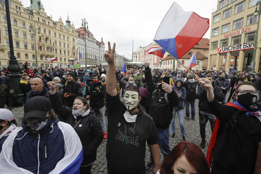 Demonstrators gather to protest the COVID-19 preventative measures downtown Prague, Czech Republic, Wednesday, Oct. 28, 2020. Coronavirus infections i...