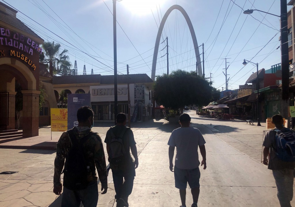 Expelled migrants walking in Tijuana, Mexico, Oct. 8, 2020. President Donald Trump's reshaping of U.S. immigration policy may be most felt in his undo...