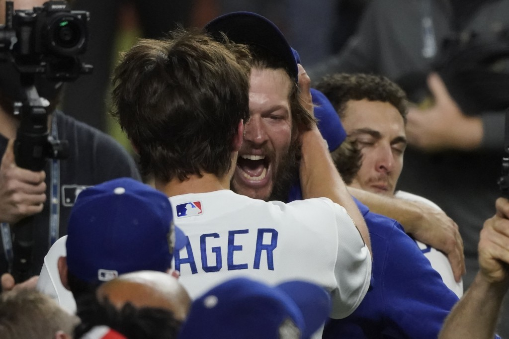 Los Angeles Dodgers pitcher Clayton Kershaw celebrates they defeat the Tampa Bay Rays 3-1 to win the baseball World Series in Game 6 Tuesday, Oct. 27,...