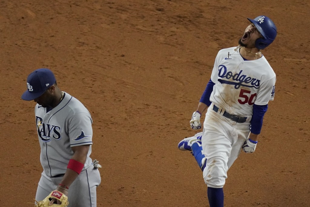 Los Angeles Dodgers' Mookie Betts celebrates after a home run against the Tampa Bay Rays during the eighth inning in Game 6 of the baseball World Seri...