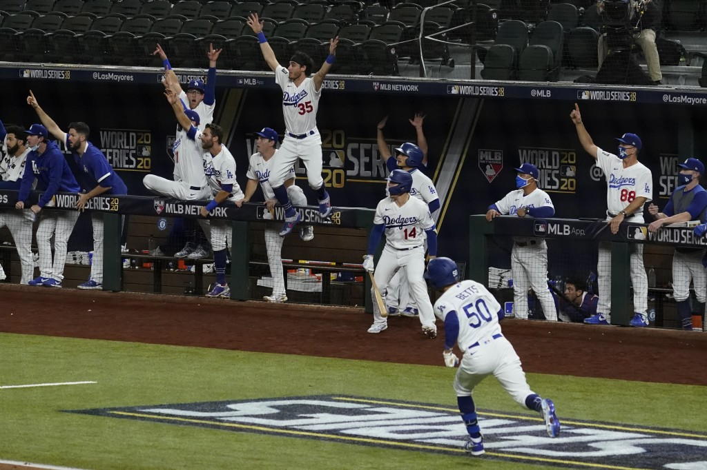 Los Angeles Dodgers' Mookie Betts rounds the bases after a home run against the Tampa Bay Rays during the eighth inning in Game 6 of the baseball Worl...