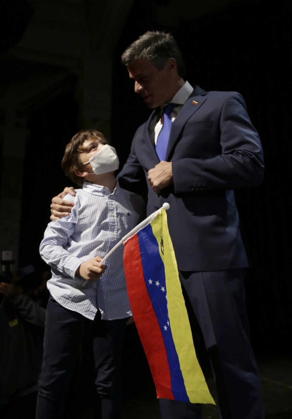 Venezuelan opposition leader Leopoldo Lopez arrives with his soon Leopoldo during press conference in Madrid on Tuesday, Oct. 27, 2020. Prominent oppo...