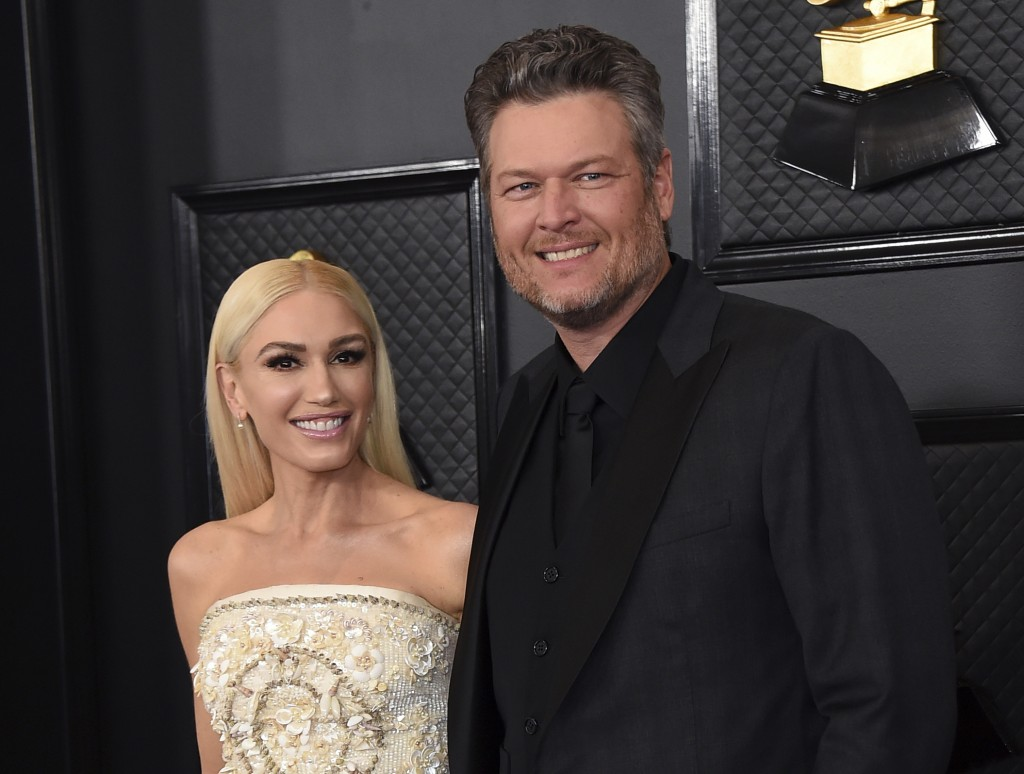 FILE - Gwen Stefani, left, and Blake Shelton arrive at the 62nd annual Grammy Awards in Los Angeles on Jan. 26, 2020. Shelton and Stefani posted a pic...
