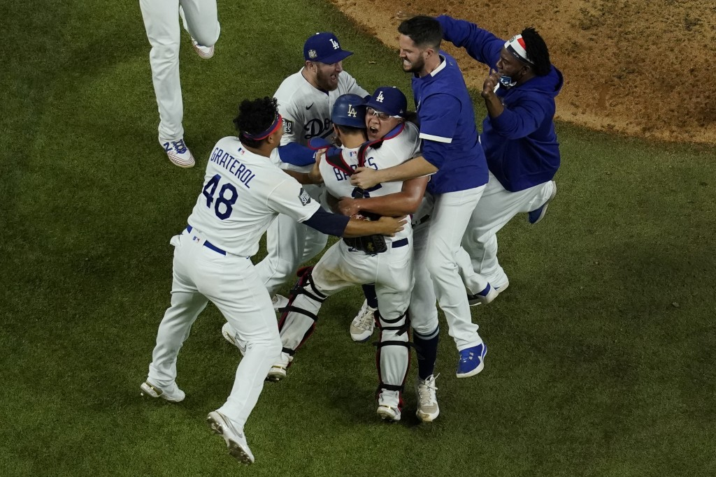 Los Angeles Dodgers celebrate after defeating the Tampa Bay Rays 3-1 to win the baseball World Series in Game 6 Tuesday, Oct. 27, 2020, in Arlington, ...