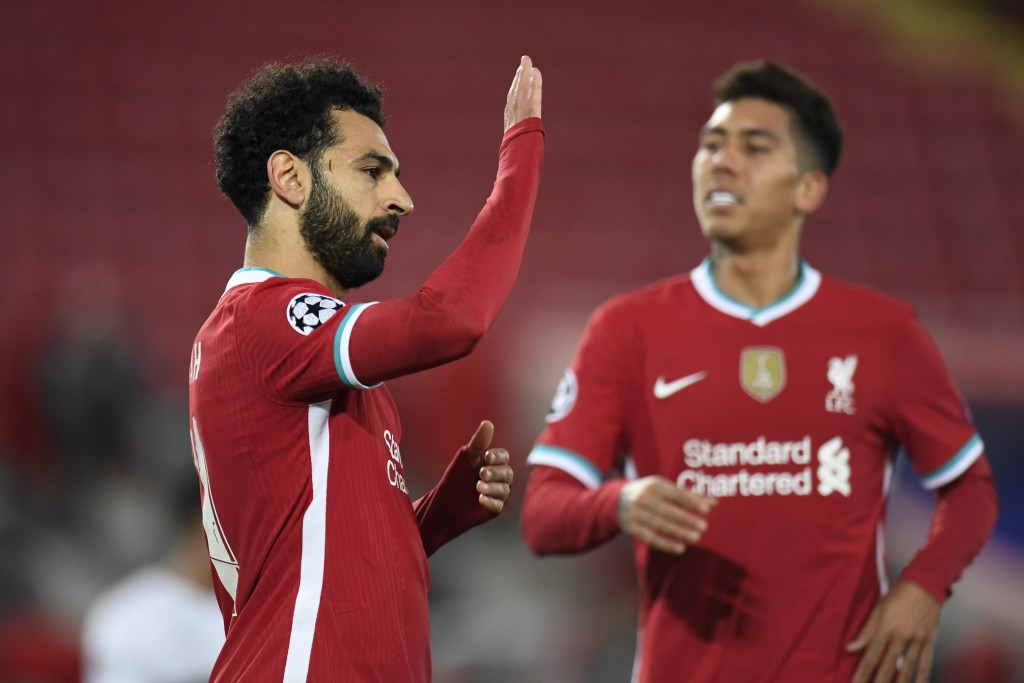 Liverpool's Mohamed Salah, left, celebrates with Liverpool's Roberto Firmino, right, after Salah scored his side's second goal during the Champions Le...
