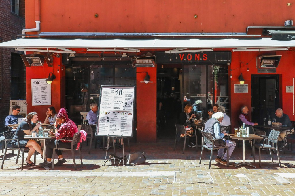 Outdoor diners are seen dining outdoors in a laneway in Melbourne, Australia, Wednesday, Oct. 28, 2020. In Melbourne, Australia's former coronavirus h...