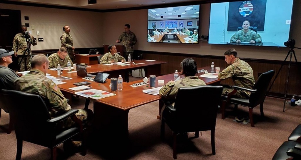 In this image provided by the U.S. Army, panelists listen to a U.S. Army soldier pitch his idea during the inaugural Dragon Innovation Challenge at Fo...