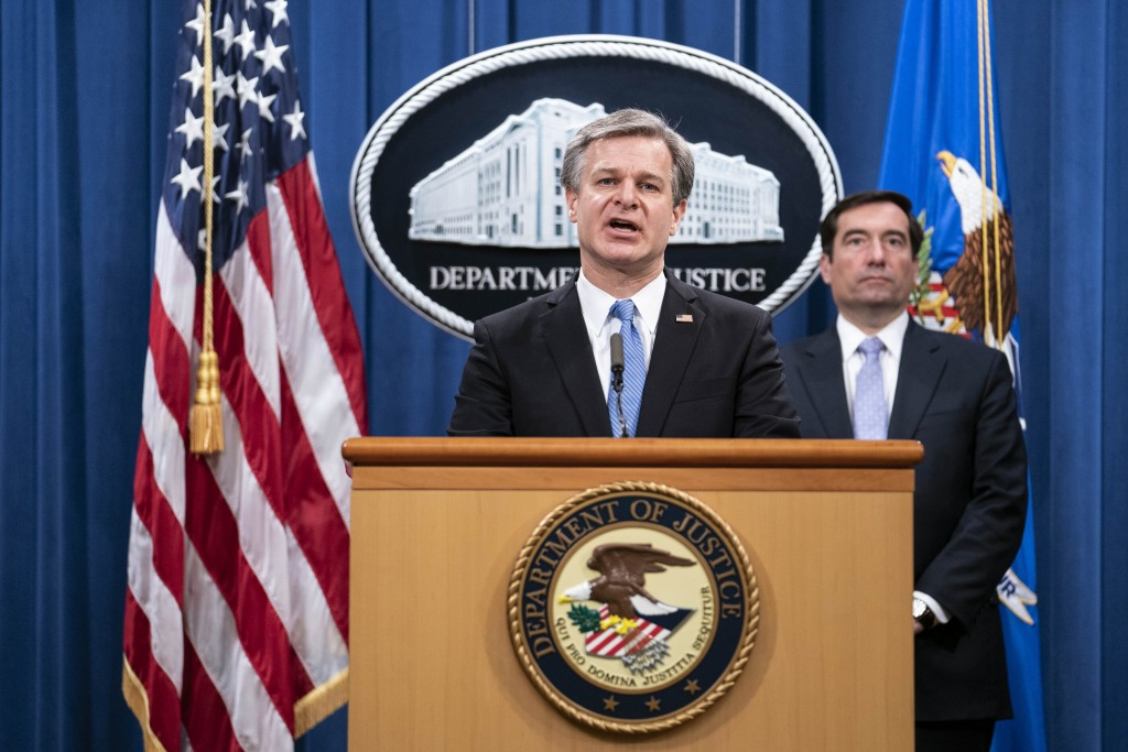 FBI Director Christopher Wray speaks during a virtual news conference at the Department of Justice, Wednesday,  Oct. 28, 2020 in Washington, as Assist...