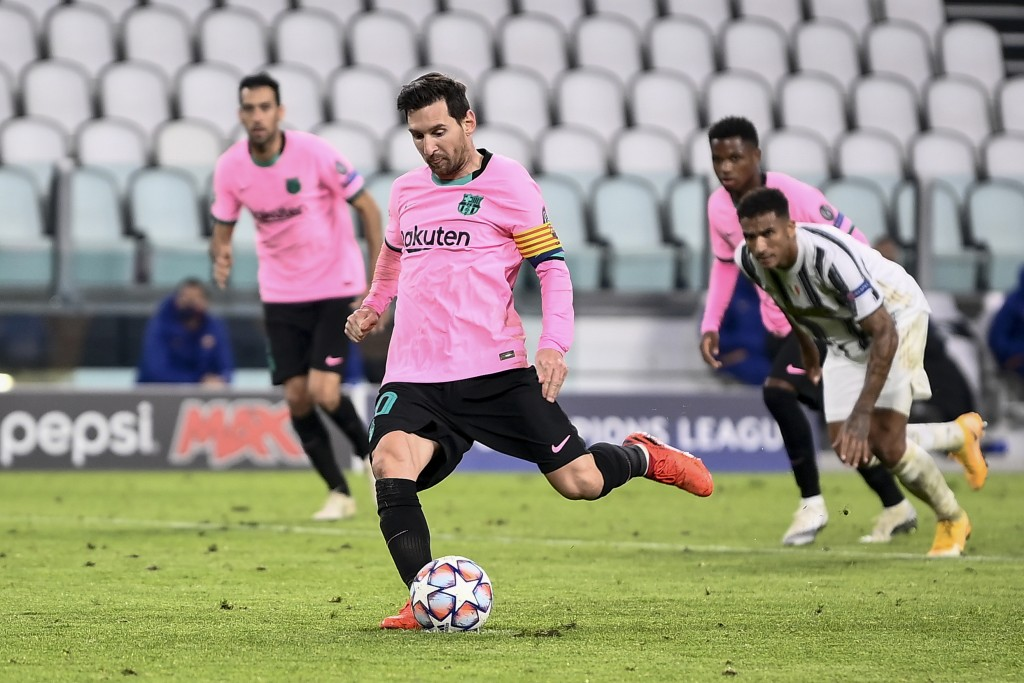 Lionel Messi of FC Barcelona scores a goal on penalty against Juventus F.C. during a group stage soccer match of UEFA Champions League in Turin, Italy...