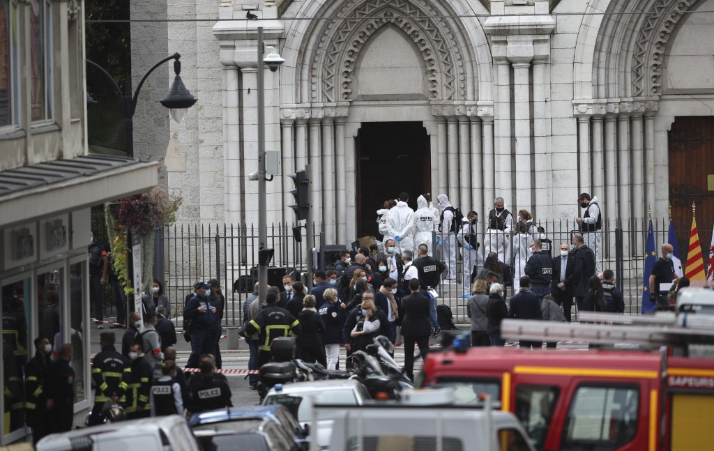 Police officers work at the Notre Dame church in Nice, southern France, after a knife attack took place on Thursday, Oct. 29, 2020. An attacker armed ...