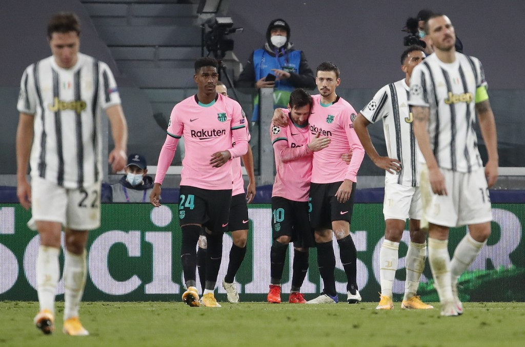 Barcelona's Lionel Messi, center, celebrates after scoring his side's second goal during the Champions League group G soccer match between Juventus an...