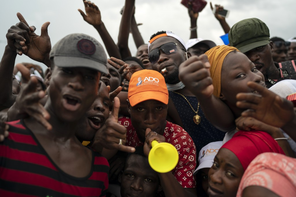 Supporters cheer for Ivory Coast President Alassane Ouattara before his arrival at a rally in Anyama, in the outskirts of Abidjan, Ivory Coast, Wednes...