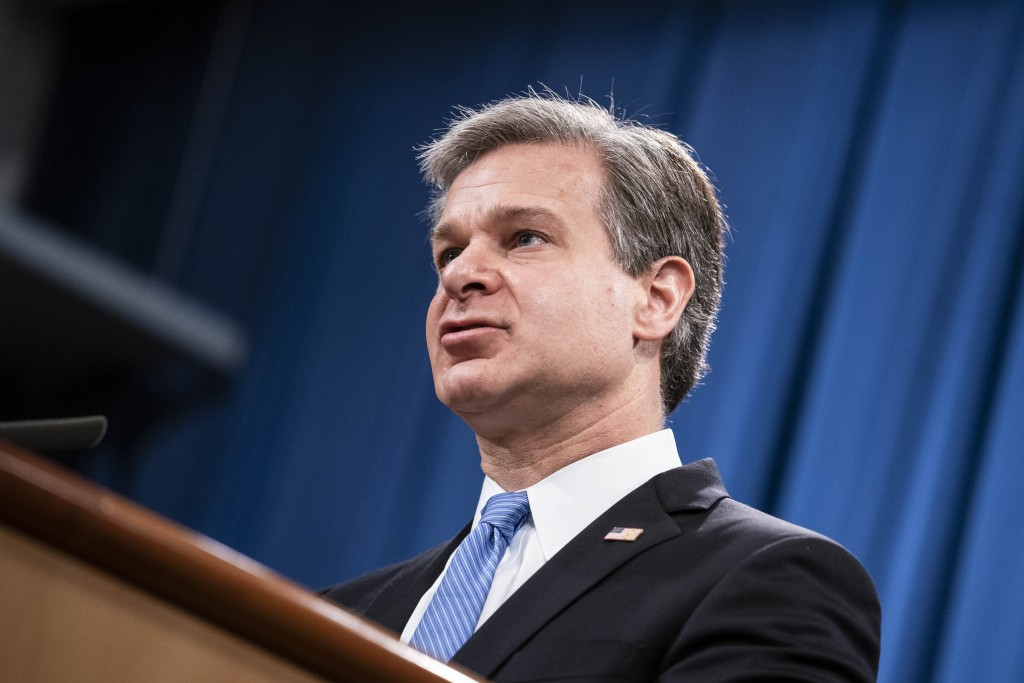 FBI Director Christopher Wray speaks during a virtual news conference at the Department of Justice, Wednesday,  Oct. 28, 2020 in Washington. The Justi...