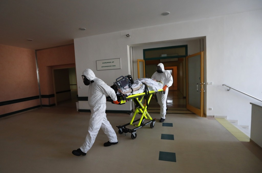 Health care workers transport a COVID-19 patient from an intensive care unit (ICU) at a hospital in Kyjov to hospital in Brno, Czech Republic, Thursda...