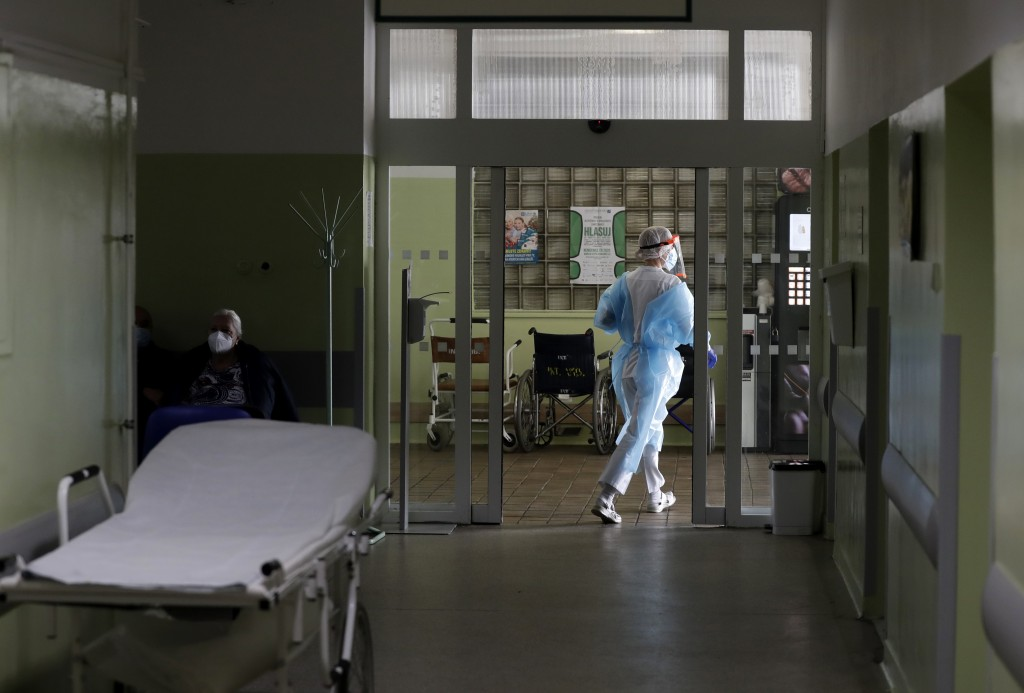 A health care worker walks in hallway at a hospital in Kyjov, Czech Republic, Thursday, Oct. 22, 2020. With cases surging in central Europe, some coun...
