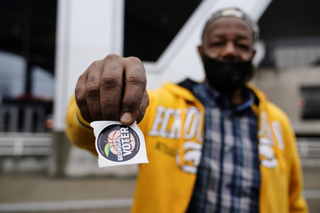 """Gary Ragland, 64, votes for the first time at State Farm Arena during early voting on Wednesday, Oct. 28, 2020, in Atlanta. """"I feel so good, its great..."""
