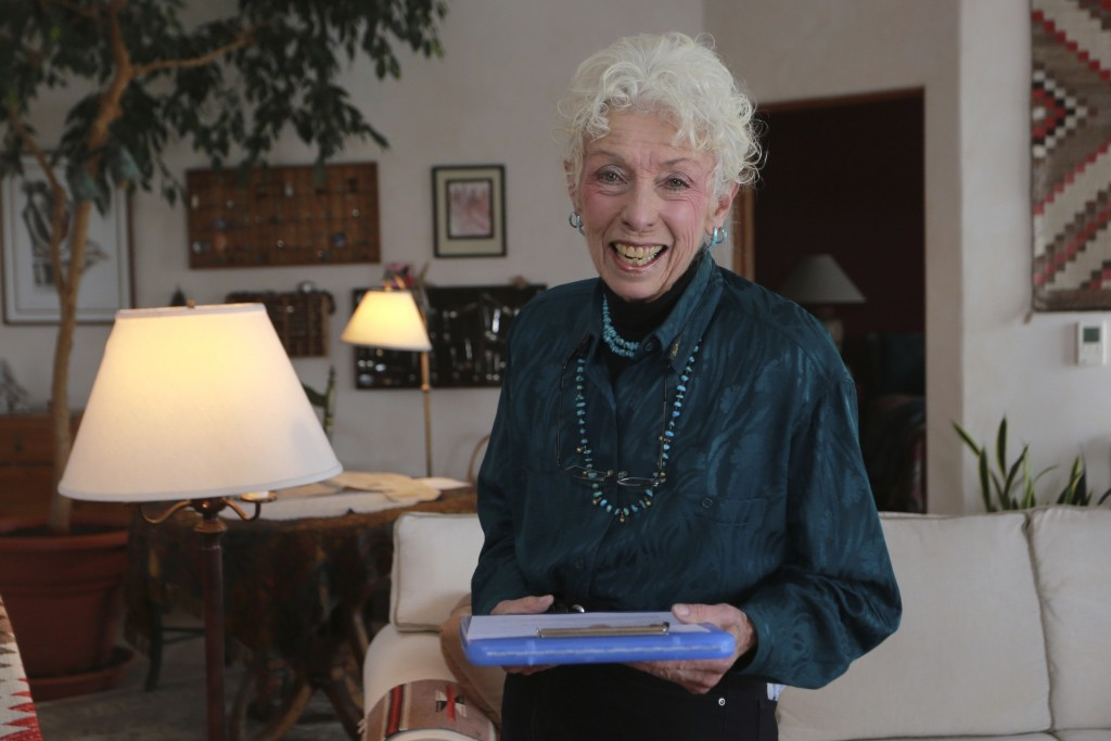Get-out-the-vote letter writer Nancy Gehman poses for a photo at her home on Tuesday, Oct. 27, 2020, in Santa Fe, New Mexico. Gehman is one of 182,000...