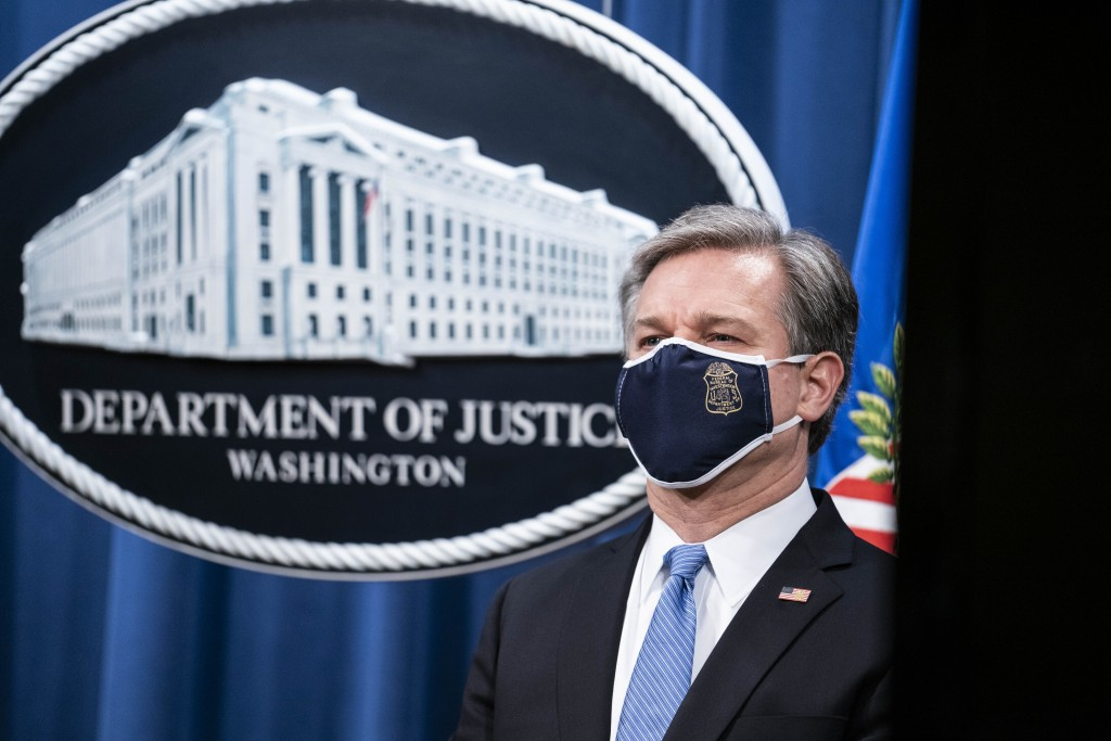 FBI Director Christopher Wray listens during a virtual news conference at the Department of Justice, Wednesday,  Oct. 28, 2020 in Washington. The Just...