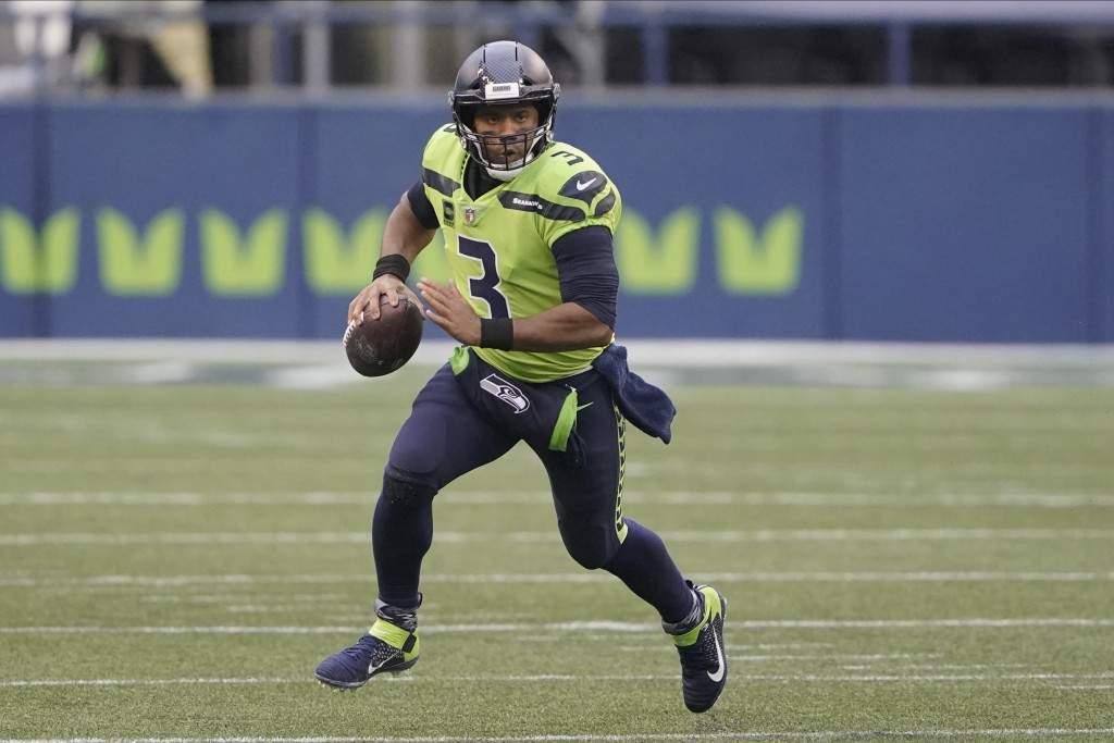 FILE - In this Oct. 11, 2020, file photo, Seattle Seahawks quarterback Russell Wilson looks for a receiver during the first half of the team's NFL foo...