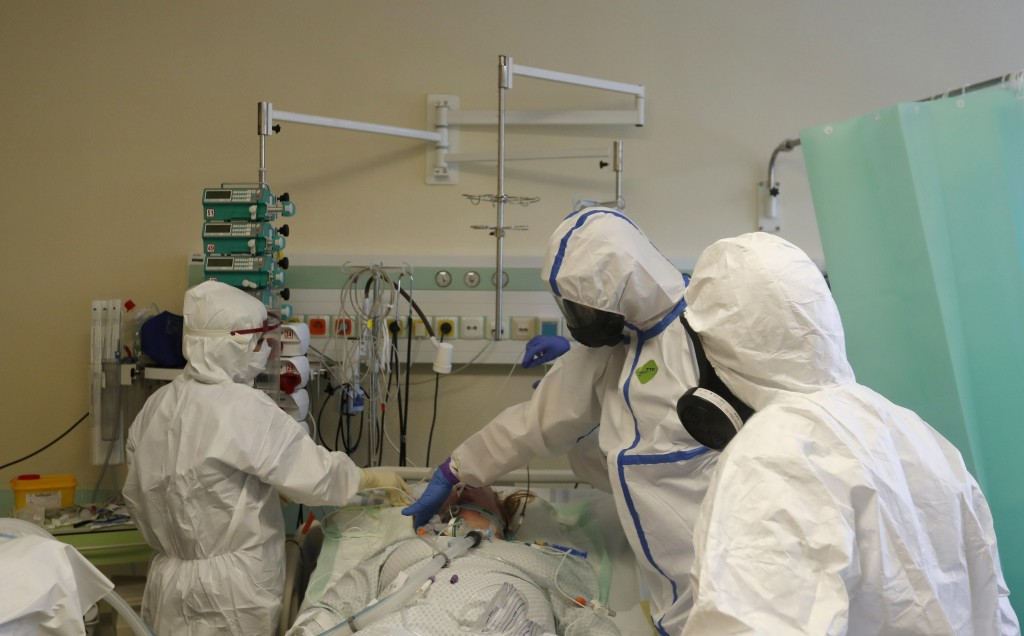 Health care workers prepare to transport a COVID-19 patient from an intensive care unit (ICU) at a hospital in Kyjov to hospital in Brno, Czech Republ...