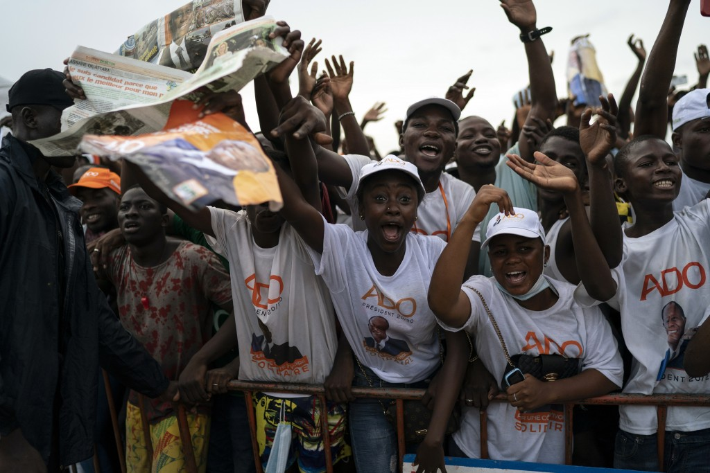 Supporters cheer as Ivory Coast President Alassane Ouattara arrives at a rally in Anyama, in the outskirts of Abidjan, Ivory Coast, Wednesday, Oct. 28...