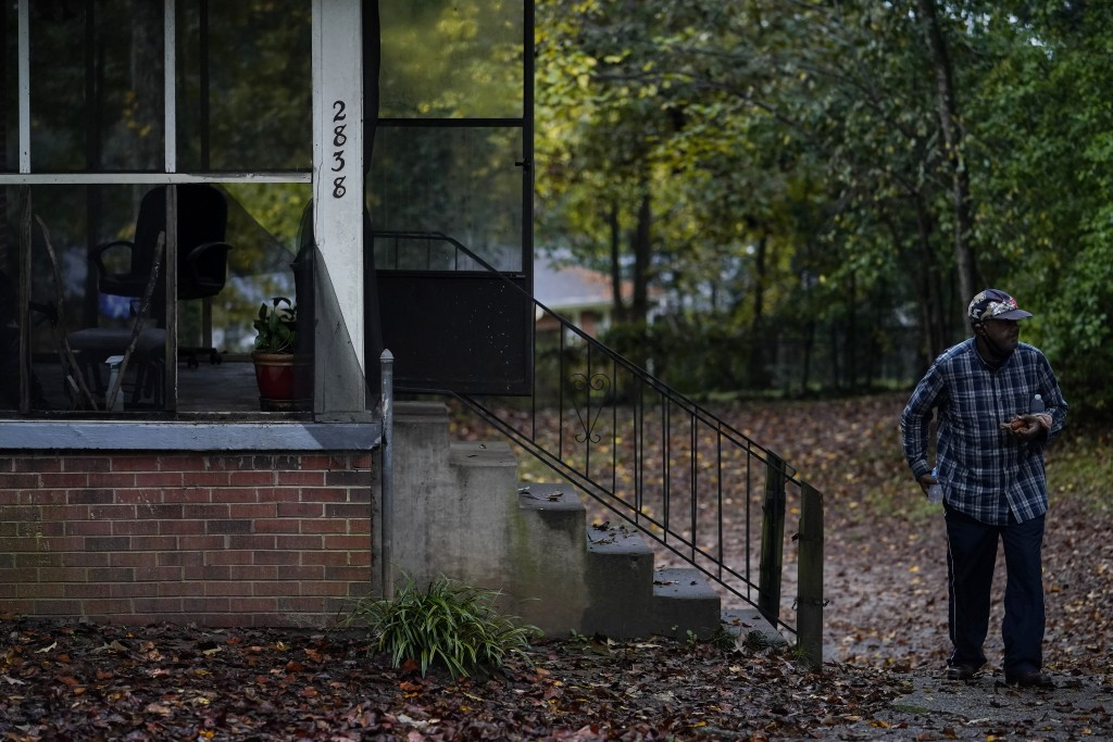"""First time voter, Gary Ragland, 64, of East Point, Ga., walks out of his home to go vote early with a non-profit organization called the """"Roll to the ..."""