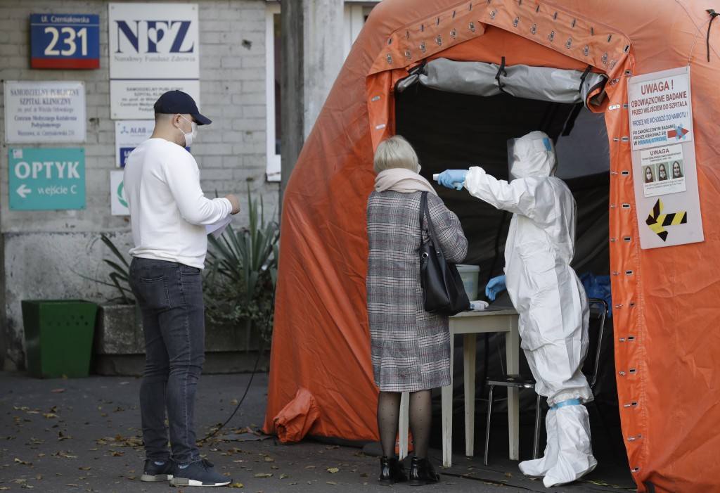 People arrive to be tested for COVID-19 in Warsaw, Poland, Thursday, Oct.22, 2020.