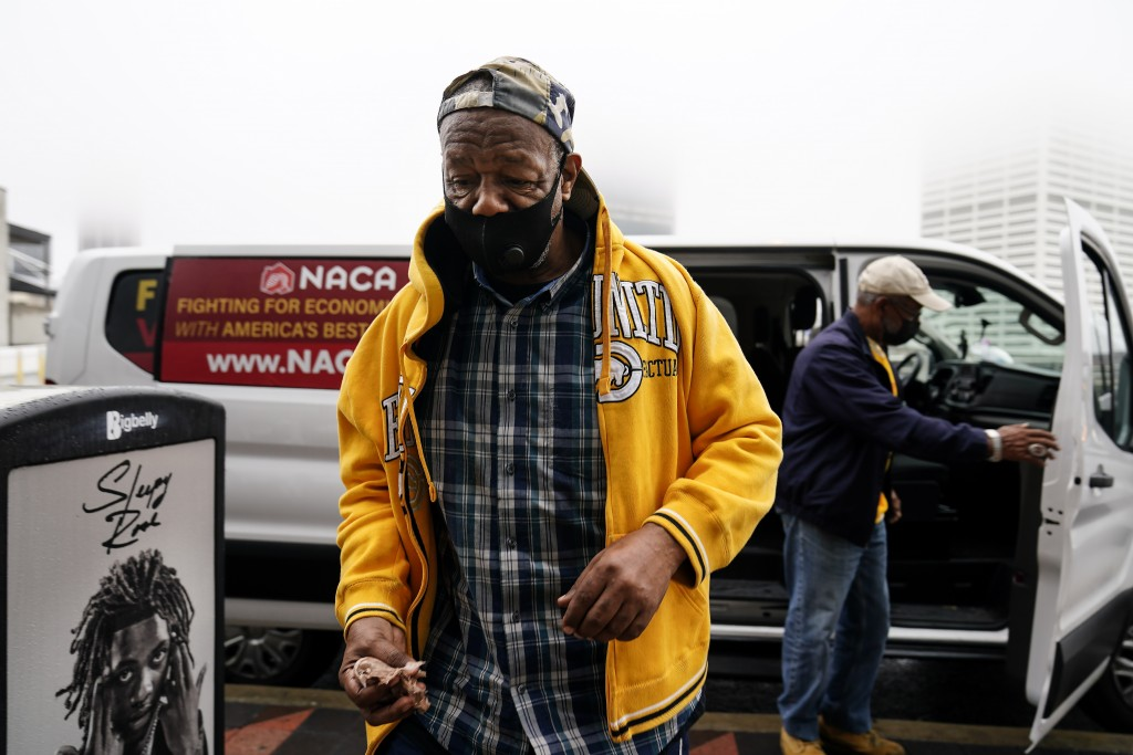 """First time voter, Gary Ragland, 64, of East Point, Ga., arrives to State Farm Arena in a van provided by NACA for an event called """"Roll to the Polls"""" ..."""