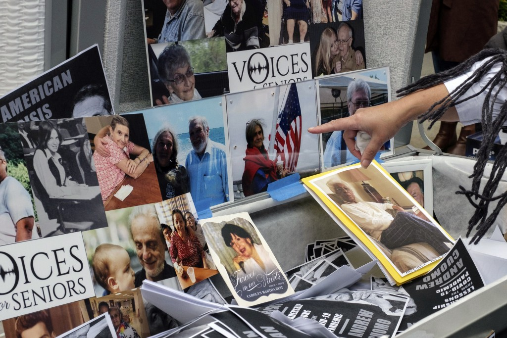 FILE - In this Oct. 18, 2020, file photo, families of COVID-19 victims who died in New York nursing homes gather in front of Cobble Hill Heath Center ...