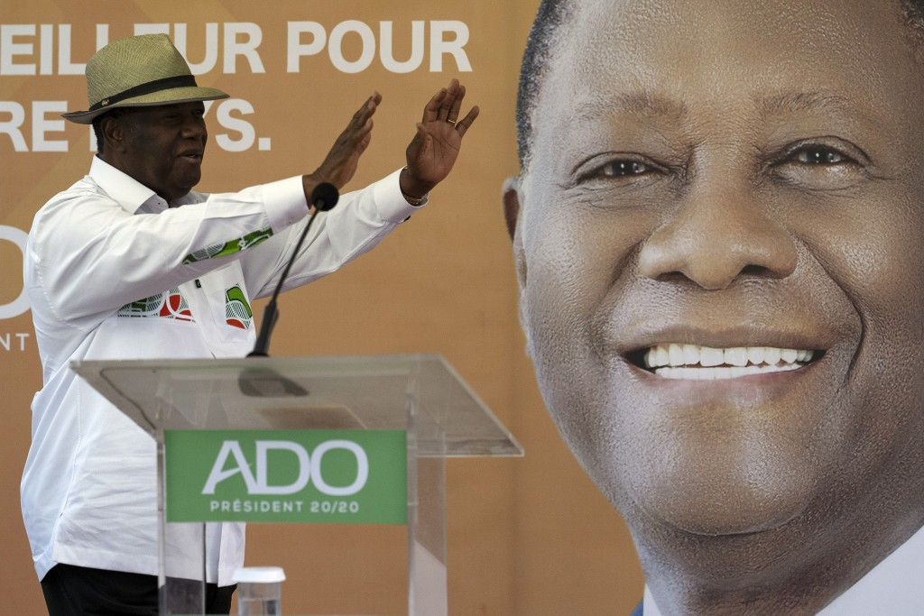 Ivory Coast President Alassane Ouattara waves to supporters before speaking at a rally in Anyama, outskirts of Abidjan, Ivory Coast, Wednesday, Oct. 2...